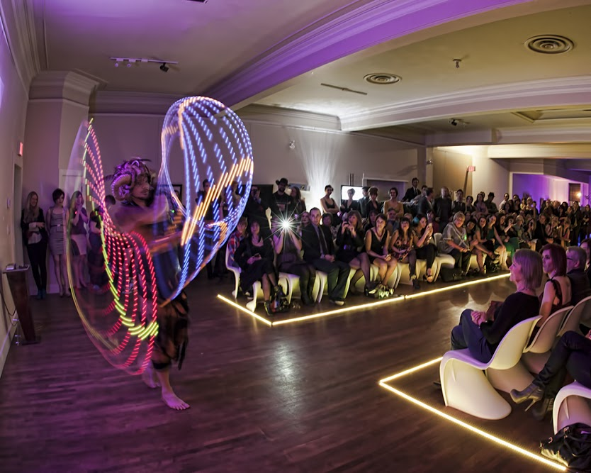 "Designer Kyle Nylund's ""Grandstand"" features performer Geoffrey Szuszkiewicz in a two-hoop performance. Photo: Jeff McDonald Photography"